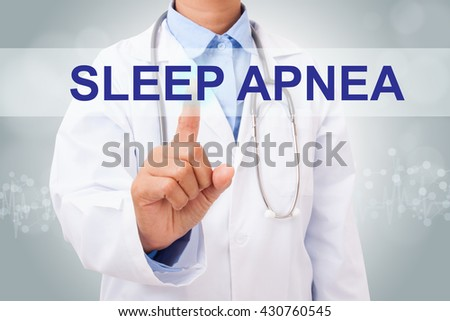 Doctor hand touching sleep apnea sign on virtual screen. medical concept