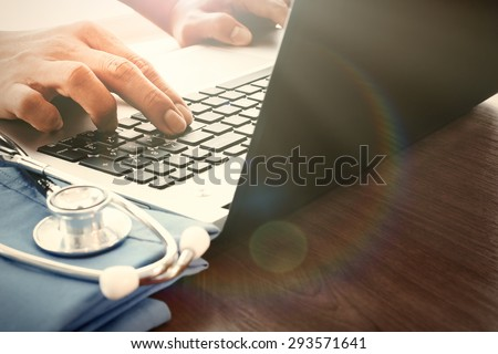 Doctor hand working with laptop computer in medical workspace office as concept - stock photo