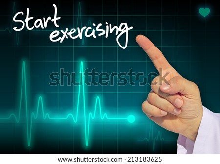 Doctor hand writing message START EXERCISING with heart rate monitor in the background - stock photo