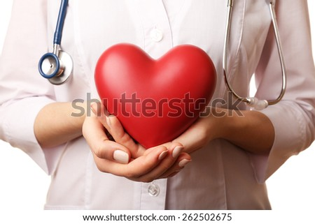 Doctor hands with heart and stethoscope on white background. closeup - stock photo