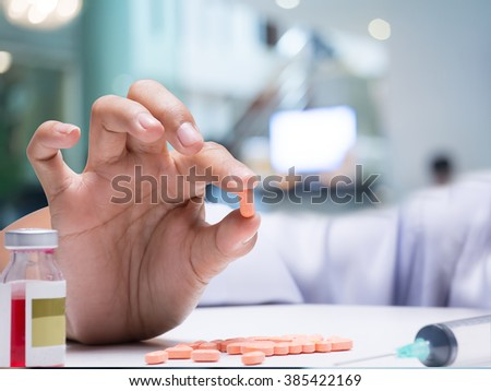 Doctor hold the medicine on his hand    - stock photo