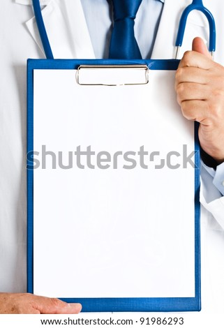 Doctor holding a blank medical chart - stock photo