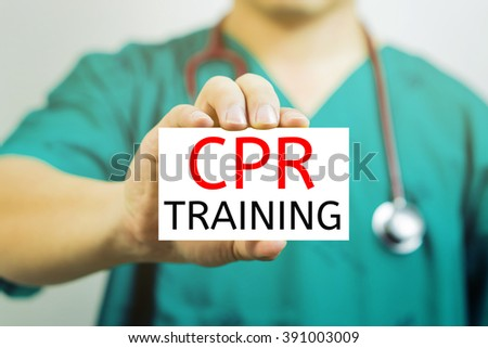 Doctor holding a  business card with capital lettering   CPR TRAINING in hand,Doctor shows card.Medical and healthcare  concept, medical support and service concept, Selective focus.vintage tone. - stock photo