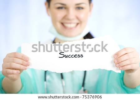 Doctor holding a sign - stock photo