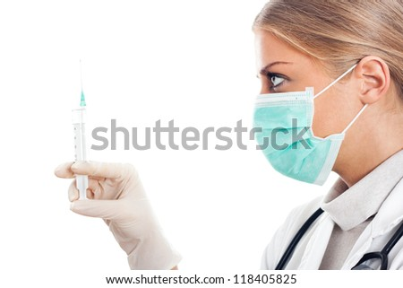 Doctor holding a syringe in her hand,Doctor with syringe