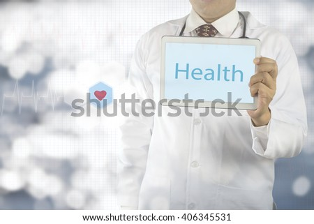 Doctor holding a tablet pc with health text  on screen, medical concept - stock photo