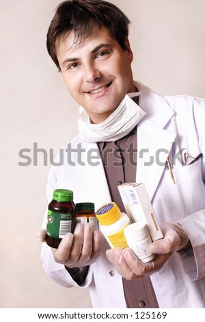 Doctor holding a variety of medicines and supplements - stock photo