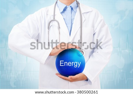 Doctor holding blue crystal ball with Energy sign on medical background. - stock photo