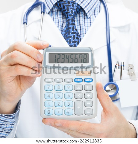 Doctor holding calculator in hands - health care concept - studio shot - stock photo