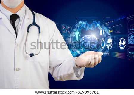 doctor holding glow hi-tech healthcare interface - stock photo