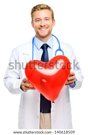 Doctor holding heart on white background - stock photo