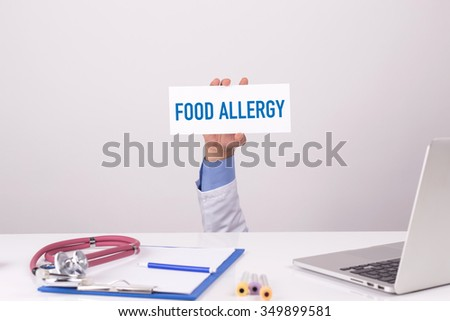 Doctor Holding Placard written FOOD ALLERGY