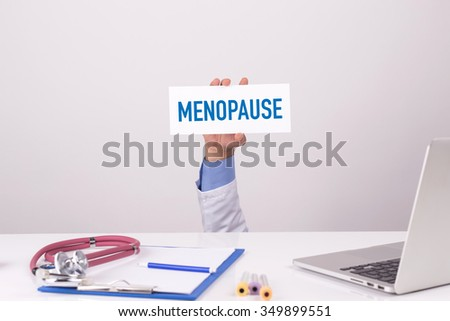 Doctor Holding Placard written MENOPAUSE