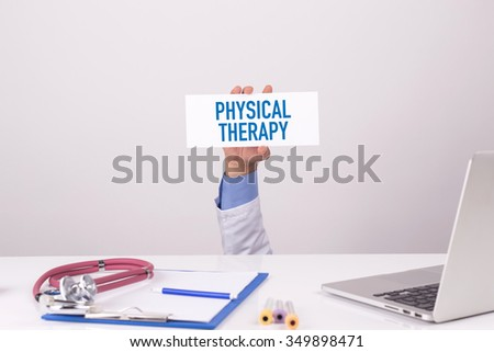 Doctor Holding Placard written PHYSICAL THERAPY