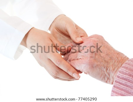 Doctor holding senior's hands - stock photo