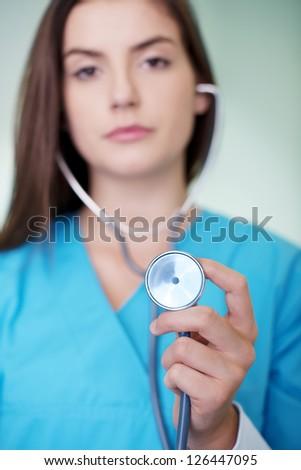 Doctor holding stethoscope - stock photo