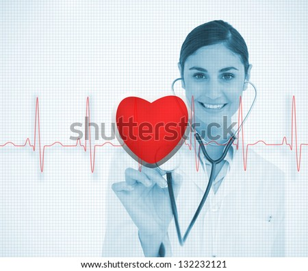 Doctor holding stethoscope up to red ECG line with heart graphic on blue grid background