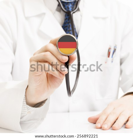 Doctor holding stethoscope with flag series - Germany - stock photo