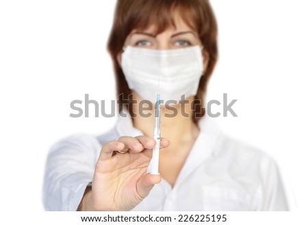 doctor holding syringe - stock photo