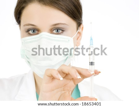 doctor holding syringe and getting ready for injection - stock photo