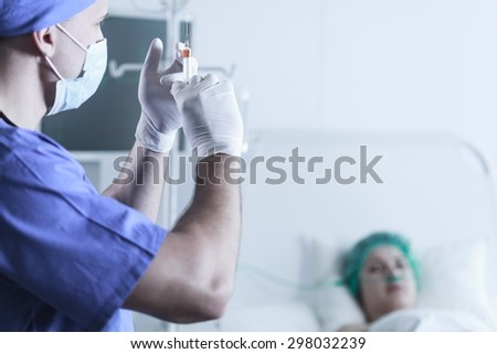 Doctor holding syringe and going to do an injection