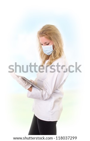 Doctor holding tablet - stock photo