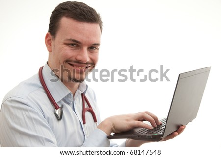 doctor holding up a laptop typing on it - stock photo