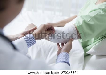 Doctor imposes bandage. - stock photo