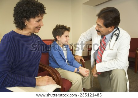 Doctor in a Conversation with Mother and Son