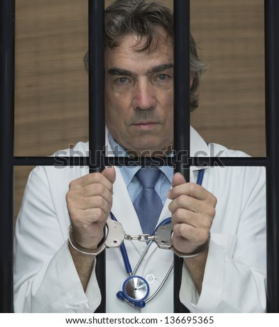 Doctor in jail. - stock photo