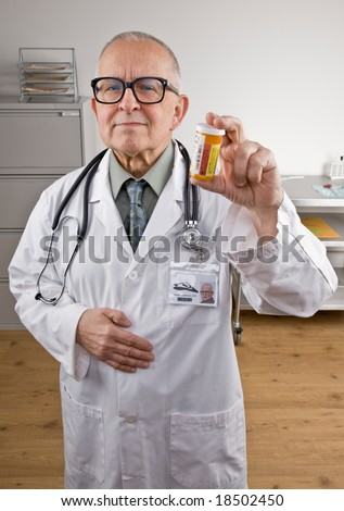 Doctor in lab coat and stethoscope holding prescription medication bottle
