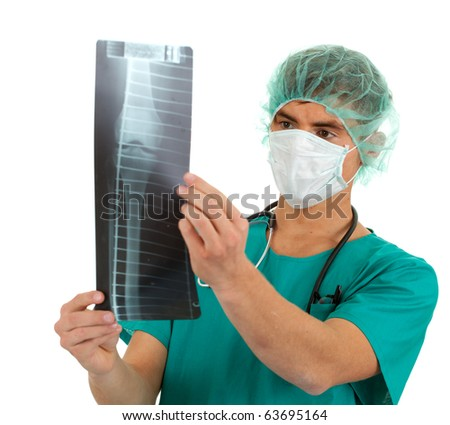doctor in medical mask looking at x-ray, leg - stock photo
