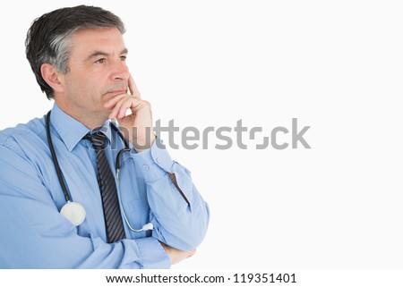 Doctor in shirt and tie deep in thought - stock photo