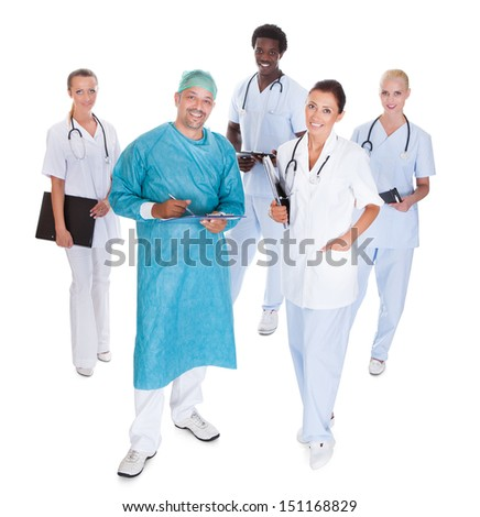 Doctor In Surgical Gown With His Coworkers Isolated Over White Background - stock photo