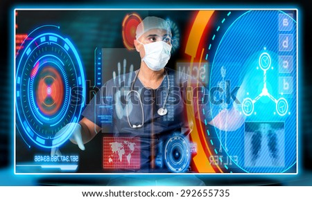 Doctor in uniform with digital  screens and keyboard - stock photo