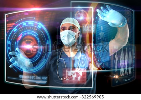 Doctor in uniform with digital  screens working - stock photo