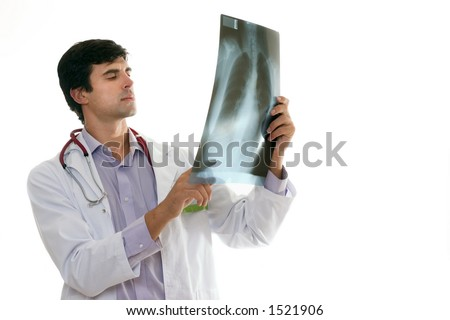 Doctor in work uniform evaluating a patient's chest x-ray. - stock photo
