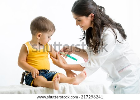doctor injecting child - stock photo