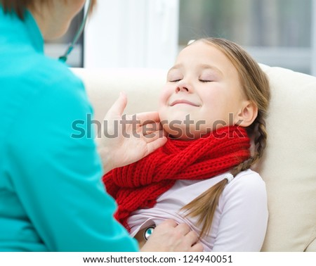 Doctor is examining little girl, indoor shoot - stock photo