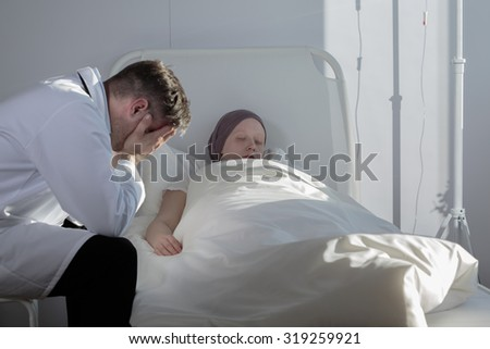 Doctor is sad because of medical results of young patient