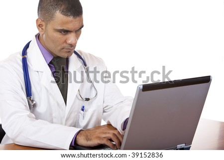 Doctor is sitting on his desk and typing on laptop. Isolated on white. - stock photo