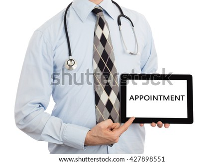 Doctor, isolated on white backgroun,  holding digital tablet - Appointment - stock photo