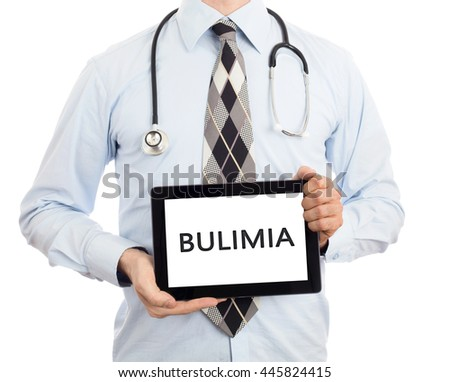 Doctor, isolated on white backgroun,  holding digital tablet - Bulimia - stock photo
