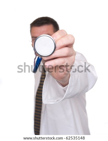Doctor isolated on white. Points stethoscope close to camera. Focus on end of stethoscope. - stock photo