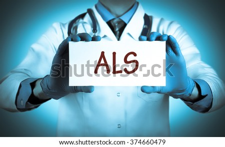 Doctor keeps a card with the name of the diagnosis - als. Selective focus. Medical concept. - stock photo