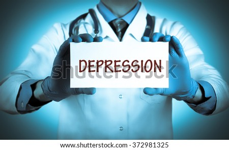 Doctor keeps a card with the name of the diagnosis - depression. Selective focus. Medical concept. - stock photo