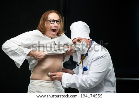 Doctor listens to a stethoscope the patient - stock photo
