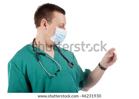 Doctor looking at a digital thermometer. - stock photo