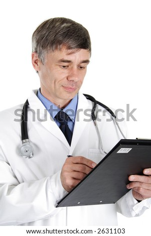 Doctor looking at a medical record - stock photo