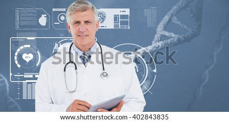 Doctor looking at camera and holding tablet against image of a dna